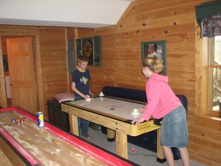 Air hockey in the games room.